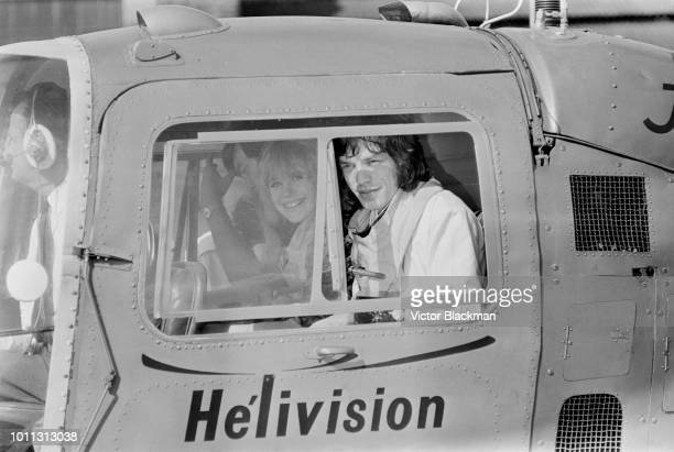 Mick Jagger and Marianne Faithfull aboard a helicopter at Battersea Heliport in London, 1st August 1967. They are flying to Ongar in Essex, where...