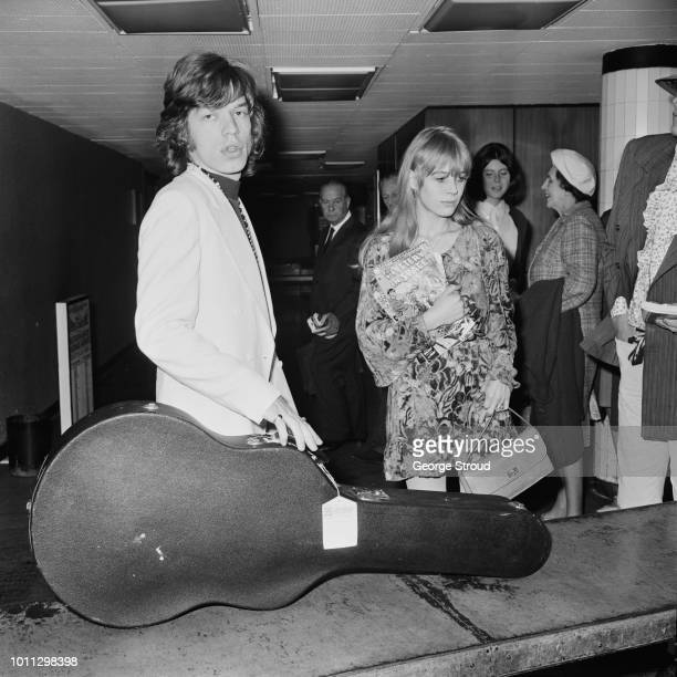 Mick Jagger and Marianne Faithfull arrive at London Airport , after a flight from Dublin, 14th August 1967.
