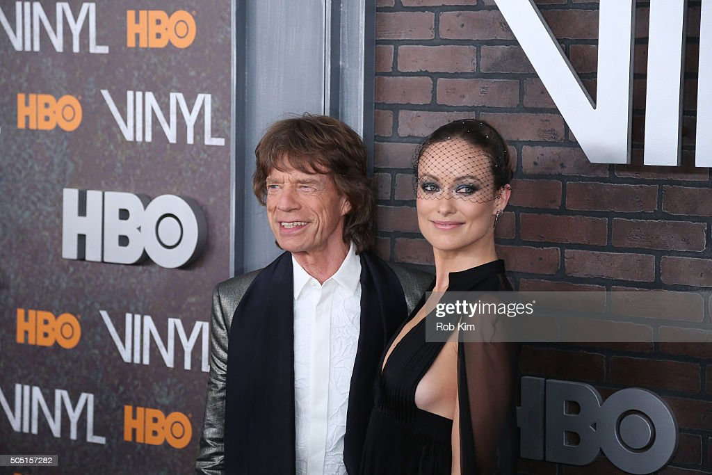 Mick Jagger (L) and Olivia Wilde attend the New York Premiere of 'Vinyl' at Ziegfeld Theatre on January 15, 2016 in New York City.