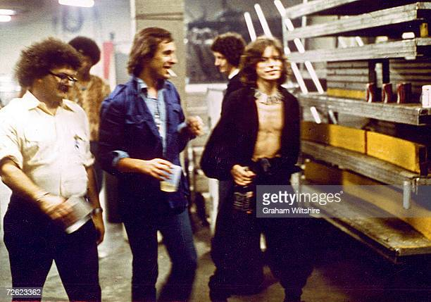 Mick Jagger and promoter Peter Rudge centre backstage before the Rolling Stones concert at Madison Square Gardens 27th June 1975