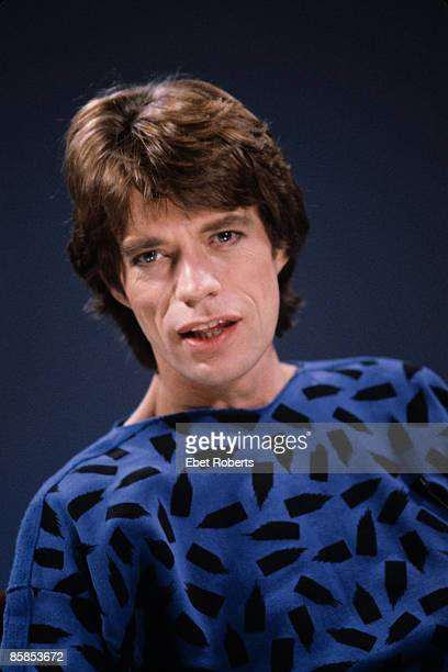 Photo of Mick JAGGER and ROLLING STONES of Rolling Stones posed studio in photo session prior to video shoot solo