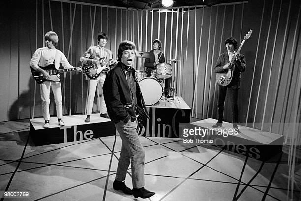 Mick Jagger and the Rolling Stones during a recording at Granada Television Studios in Manchester circa 1964 Leftright Brian Jones Keith Richards...