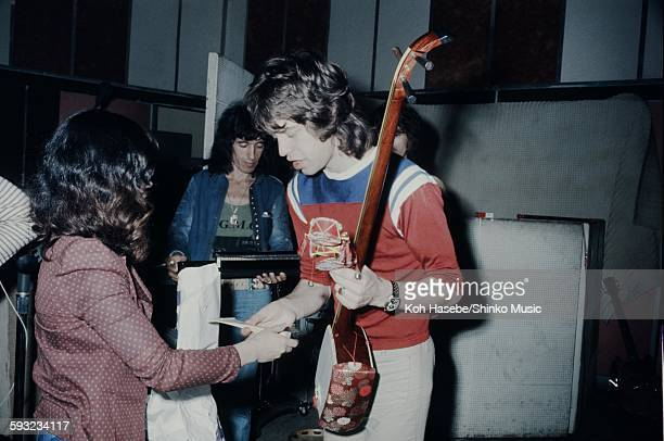 Mick Jagger Bill Wyman The Rolling Stones getting interviewed in Kingston Jamaica while recording Goats Head Soup album Kingston December 1972