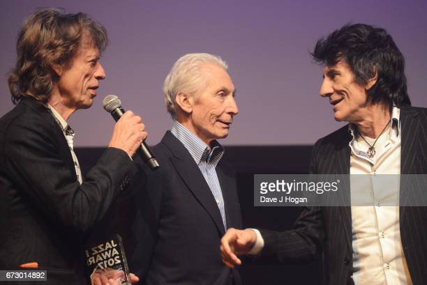 Mick Jagger Charlie Watts and Ronnie Wood of The Rolling Stones accept the award for Album Of The Year Public Vote for their album 'Blue Lonesome' at...