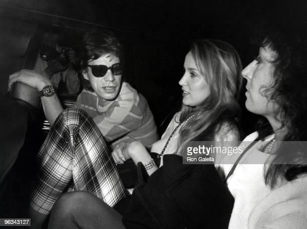 Mick Jagger Jerry Hall and Anjelica Huston