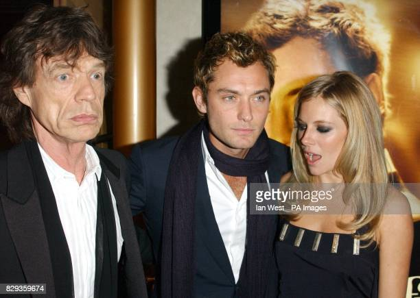 Mick Jagger Jude Law and Sienna Miller arrive for the world charity premiere of Alfie at the Empire Leicester Square in central London in aid of...