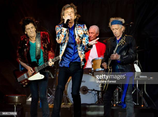 Mick Jagger Keith Richards Charlie Watts and Ronnie Wood of The Rolling Stones perform live on stage at Old Trafford on June 5 2018 in Manchester...