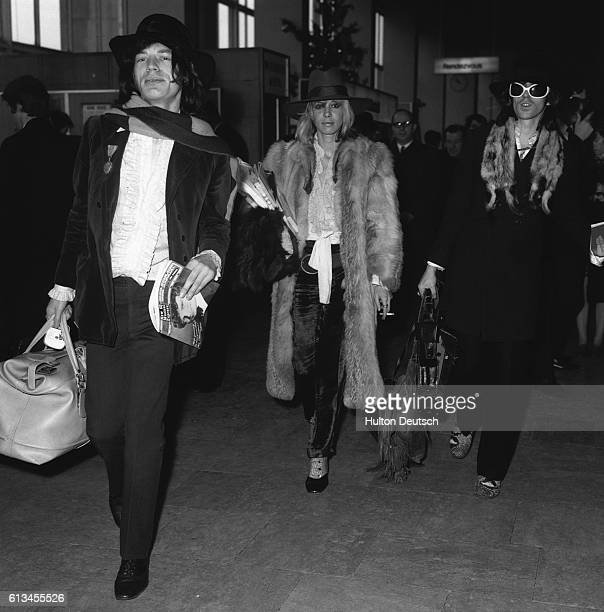 Mick Jagger Keith Richards of The Rolling Stones and Keith's girlfriend Anita Pallenberg leave London from Heathrow Airport to look for a South...