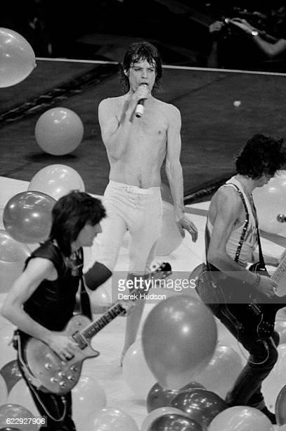 Mick Jagger lead singer of the British rock group the Rolling Stones and Bill Wyman on stage during the 1981 concert in the city of Philadelphia...