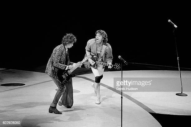 Mick Jagger lead singer of the British rock group the Rolling Stones along with other members of the group are pictured here on stage during their...