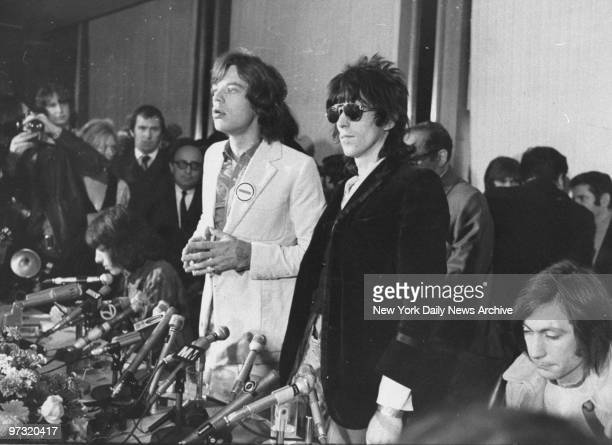 Mick Jagger lead singer of the Rolling Stones at news conference with Keith Richards and drummer Charlie Watts