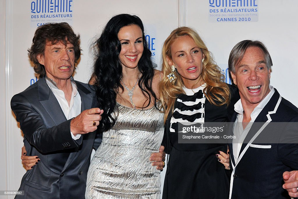 Mick Jagger, L'Wren Scott, Tommy Hilfiger and his wife Dee at the photocall for 'Stones In Exile' during the 63rd Cannes International Film Festival