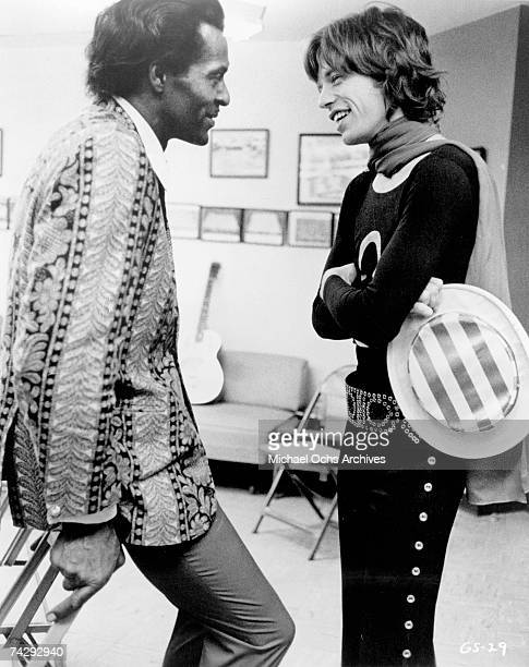 Mick Jagger of the rock and roll band 'The Rolling Stones' chats backstage with Chuck Berry at Madison Square Garden in a concert that was recorded...