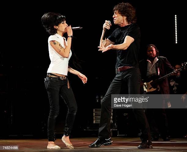 Mick Jagger of the Rolling Stones and Amy Winehouse perform on stage on the final day of the Isle of Wight Festival 2007 in Newport on June 10 2007...