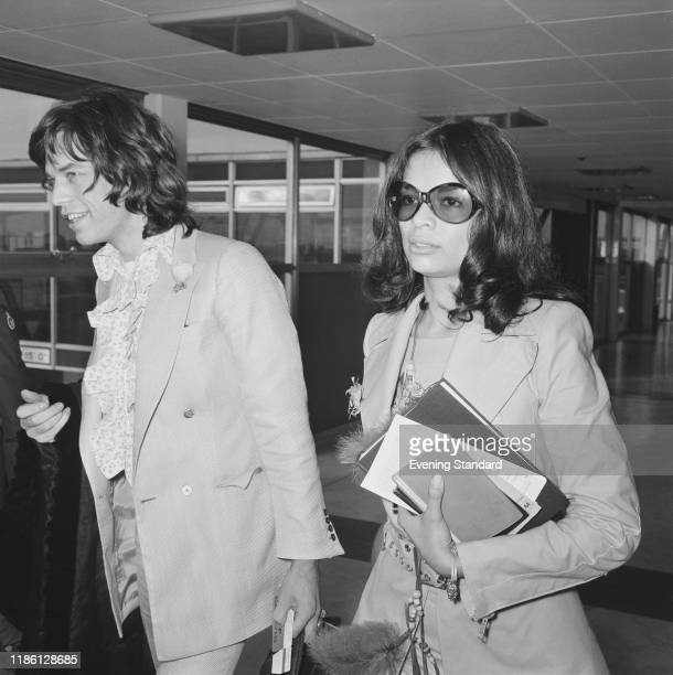 Mick Jagger of the Rolling Stones and his girlfriend Bianca Perez-Mora Macias arrive at London's Heathrow Airport to catch a flight to the Bahamas...