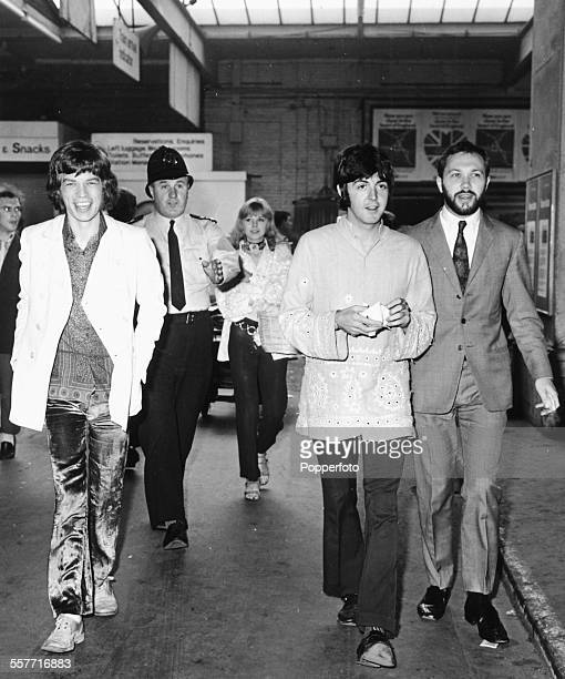 Mick Jagger of 'The Rolling Stones and Paul McCartney of 'The Beatles' with Marianne Faithful in the background are escorted through Euston Station...