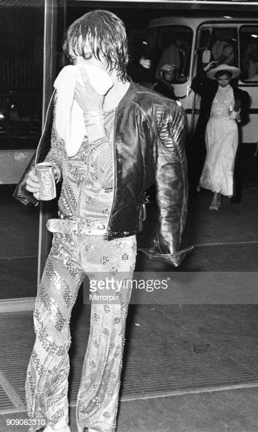 Mick Jagger of the Rolling Stones arriving at the Odeon New Street Birmingham before this evenings concert Bianca Jagger can be seen leaving the tour...