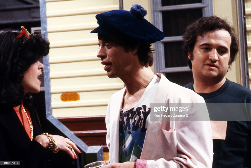 Mick Jagger of the Rolling Stones, Gilda Radner and John Belushi are photographed on the set of Saturday Night Live on October 7, 1978 in New York City.