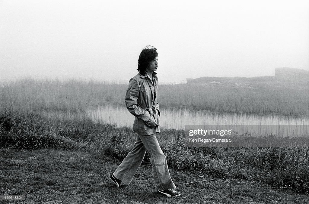 Mick Jagger of the Rolling Stones is photographed walking the marshes outside artist Andy Warhol's home in 1975 in Montauk, New York.