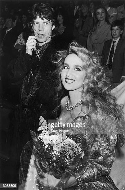 Mick Jagger of the Rolling Stones out and about with his girlfriend Texan fashion model Jerry Hall 1985