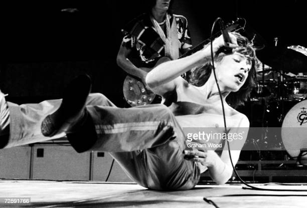 Mick Jagger of the Rolling Stones performing at Knebworth 21st August 1976 Guitarist Ron Wood can be seen in the background