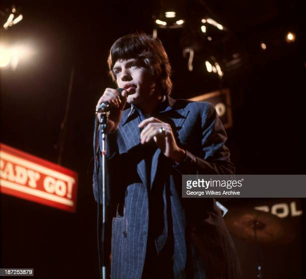 Mick Jagger of The Rolling Stones photographed during a TV performance of Ready Steady Go! The band formed in London in 1962 were in the vanguard of...