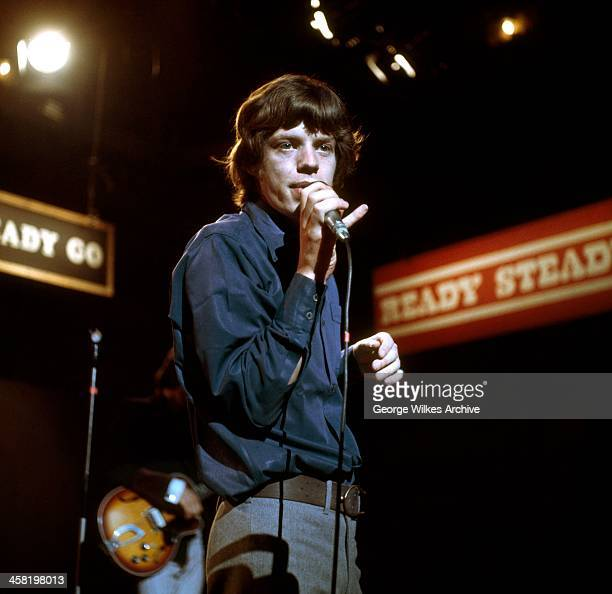 Mick Jagger of The Rolling Stones photographed during a TV performannce of Ready Steady Go! The band formed in London in 1962 were in the vanguard of...
