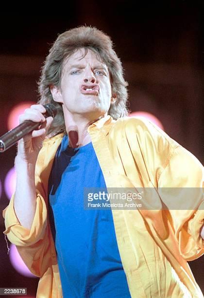 Mick Jagger performs for a sold out crowd at the Live Aid concert at JFK Stadium in Philadelphia Pennsylvania July 13 1985 Photo by Frank...