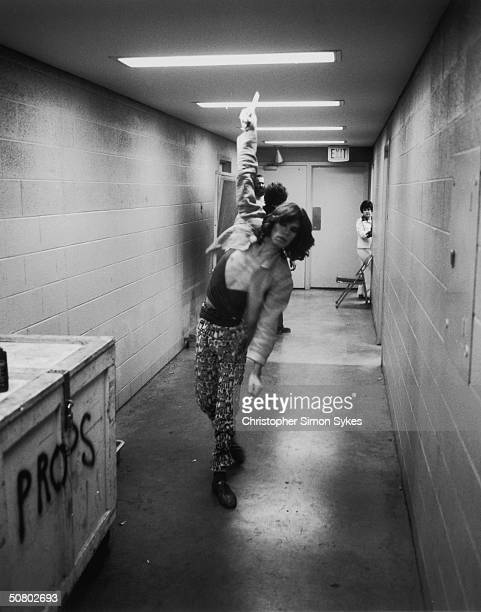 Mick Jagger practises his bowling in the corridor during the Rolling Stones Tour of the Americas 1975
