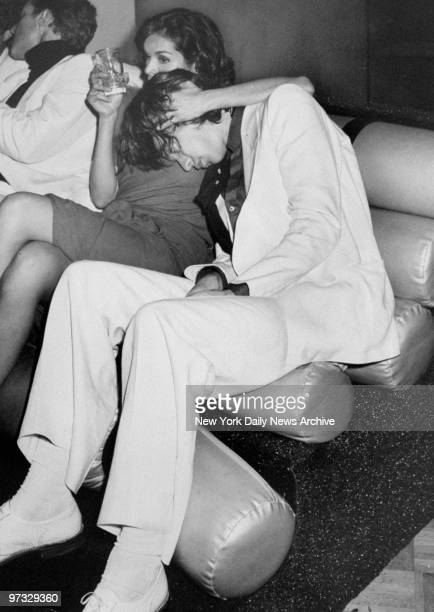 Mick Jagger rests his head on Bianca Perez Morena de Macias during her birthday party at Studio 54