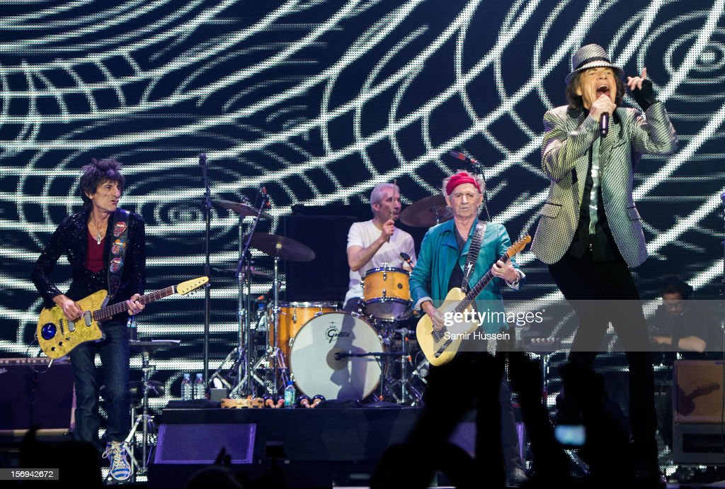 Mick Jagger (R), Ronnie Wood (L), Charlie Watts and Keith Richards (2R) of The Rolling Stones perform live on stage at the first of their 50th Anniversary concerts at the O2 Arena on November 25, 2012 in London, England.