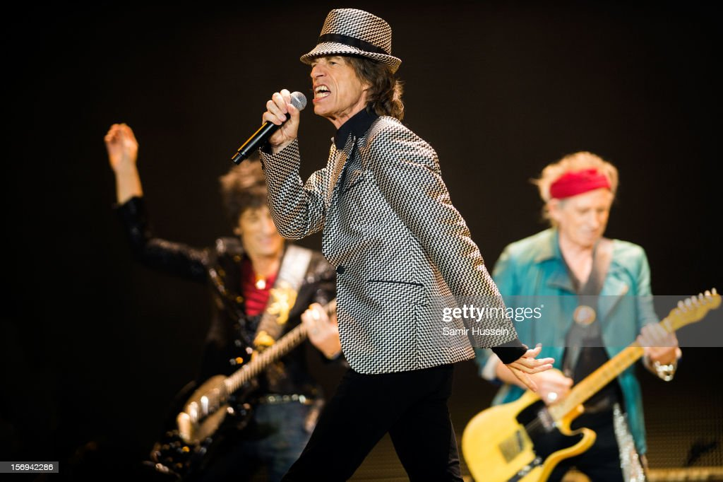Mick Jagger, Ronnie Wood (L), Keith Richards (R) of The Rolling Stones perform live on stage at the first of their 50th Anniversary concerts at the O2 Arena on November 25, 2012 in London, England.