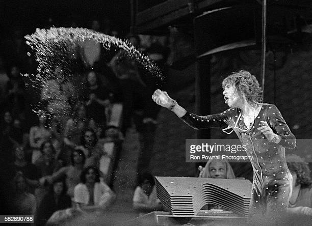 Mick Jagger tosses water on crowd as Rolling Stones perform at the Boston Garden July 18 1972