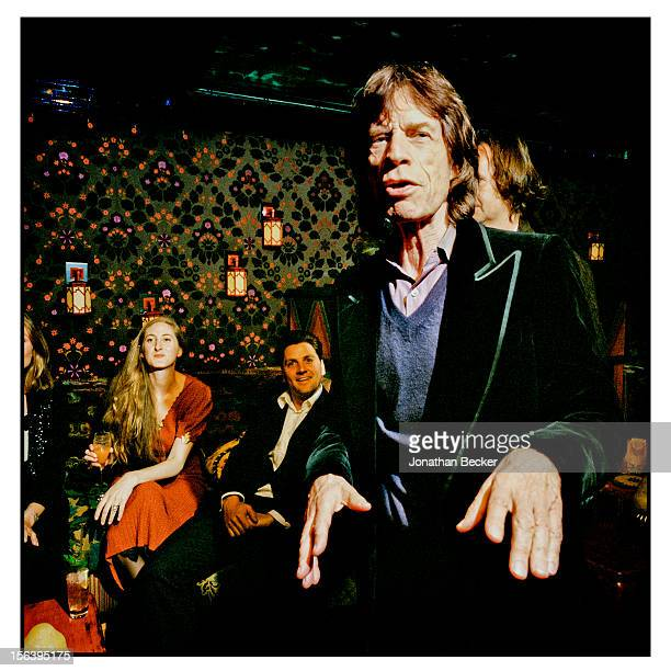 Mick Jagger, Violet Naylor-Leyland and Charles Delacherois Day are photographed celebrating the opening night of Loulou's for Vanity Fair Magazine on...