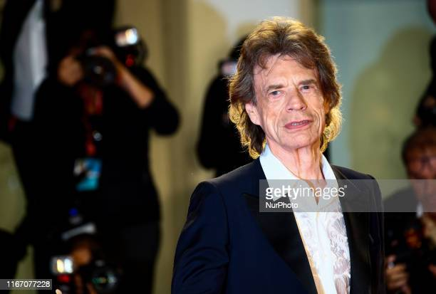 """Mick Jagger walks the red carpet ahead of the """"The Burnt Orange Heresy"""" premiere during the 76th Venice Film Festival at Sala Grande on..."""