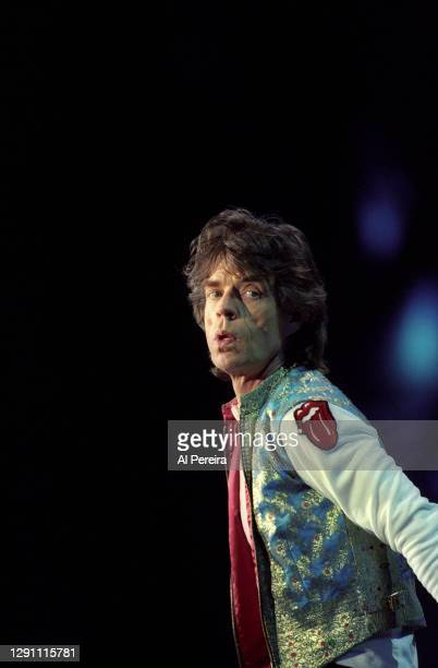 """Mick Jagger, wearing the Rolling Stones Tongue And Lips Logo patch, and The Rolling Stones perform on their """"Bridges To Babylon"""" Tour at Giants..."""