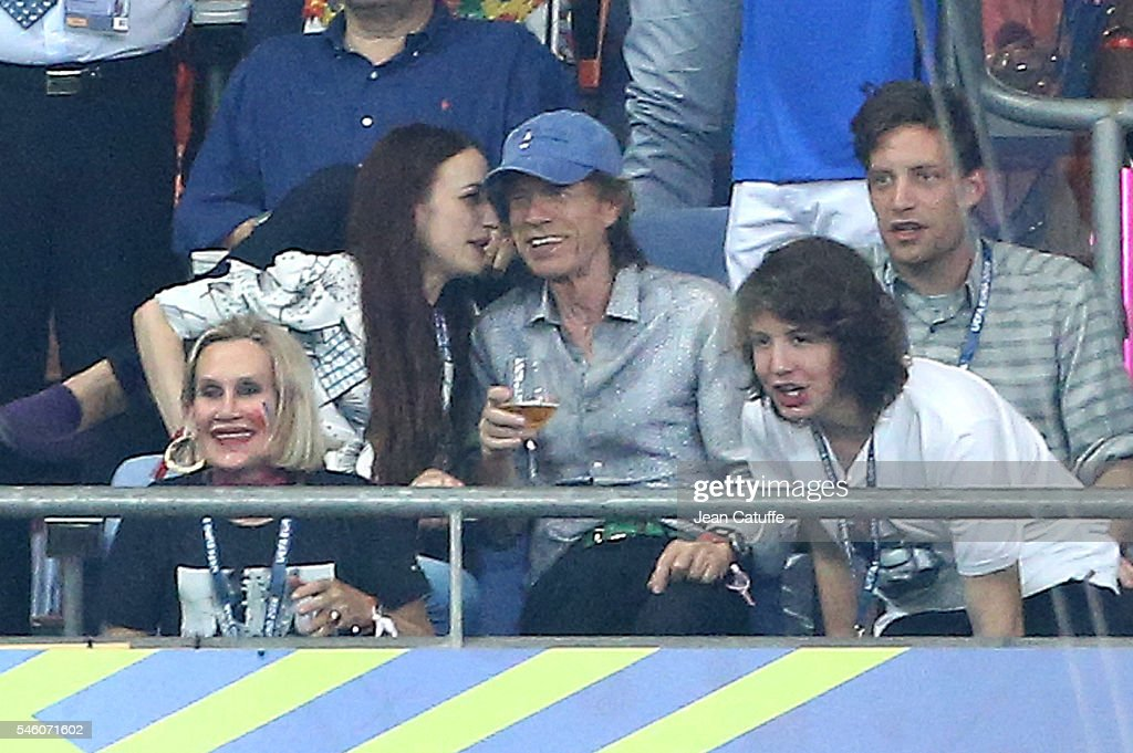 Mick Jagger with his son Lucas Jagger (below right), daughter Lizzie Jagger (L) and son James Jagger (R) attend the UEFA Euro 2016 final between Portugal and France at Stade de France on July 10, 2016 in Saint-Denis near Paris, France.