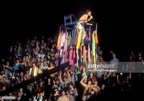 MIck Jagger/Rolling Stones performing at the Hartford Civic Center Nov 91981 Mick rides the cherry picker over the crowd