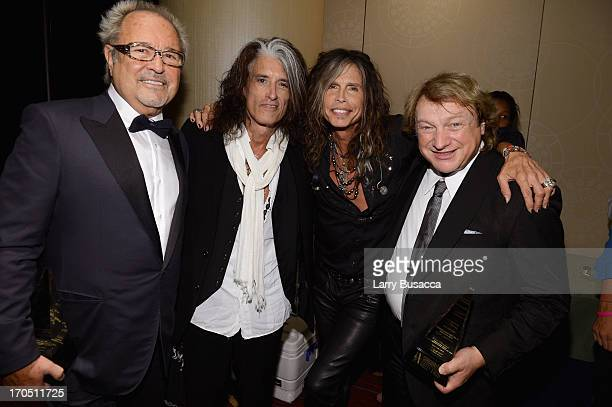 Mick Jones and Lou Gramm of Foreigner pose with Joe Perry and Steven Tyler at the Songwriters Hall of Fame 44th Annual Induction and Awards Dinner at...
