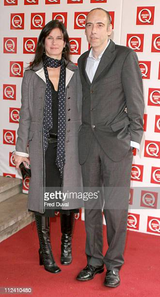Mick Jones from The Clash and guest during The 2004 Q Awards - Arrivals at Dorchester Hotel in London, Great Britain.