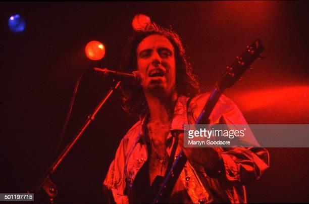 Mick Jones of Big Audio Dynamite performs on stage, United Kingdom, 1990.