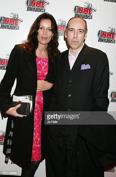 Mick Jones of The Clash arrives with an unidentified guest at The Shockwaves NME Awards 2005 at Hammersmith Palais on February 17, 2005 in London....