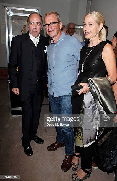 Mick Jones of The Clash Harry Enfield and wife Lucy Lyster attend the launch of 'Black Market Clash' an exhibition of personal memorabilia and items...