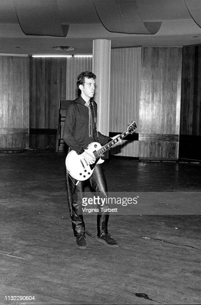 Mick Jones of The Clash in the empty auditorium during a soundcheck at Notre Dame Hall, London, 6th July 1979.