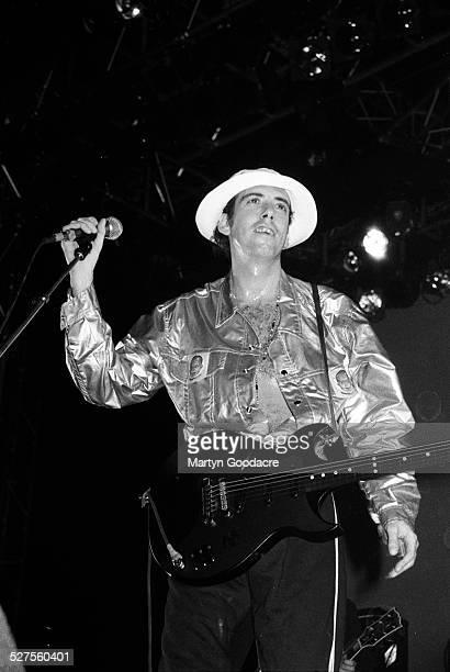 Mick Jones performs on stage with Big Audio Dynamite at Alexandra Palace, London, United Kingdom, 1990.