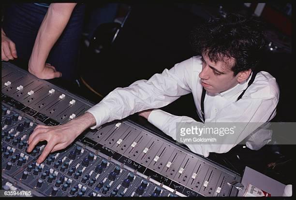 Mick Jones the guitarist for The Clash adjusts sound equipment in a recording studio