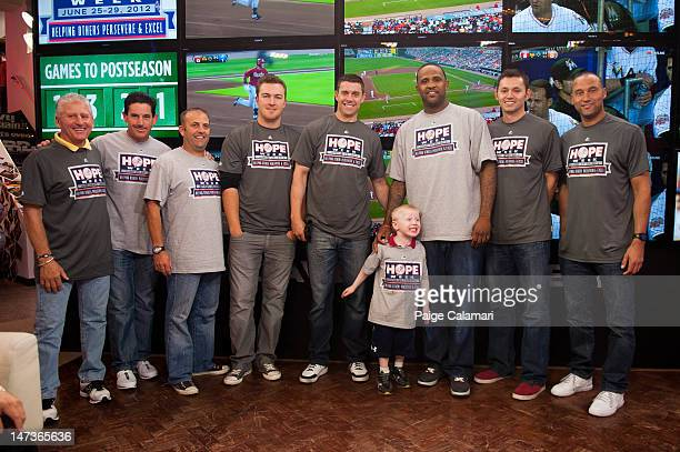 Mick Kelleher Rob Thomson Kevin Long Phil Hughes Chris Stewart CC Sabathia Clay Rapada and Derek Jeter of the New York Yankees pose with Andy Fass...
