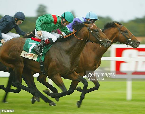 Mick Kinane and Azamour trail the John Egan ridden Norse Dancer before landing The Baileys Irish Champion Stakes race run at Leopardstown Racecourse...