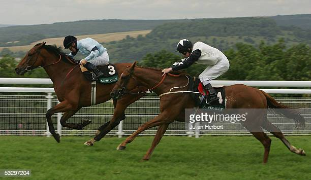 Mick Kinane and Distinction hold of the challenge of the Joe Fanning ridden Golden Quest to land The Lady O Goodwood Cup Race run at Goodwood...