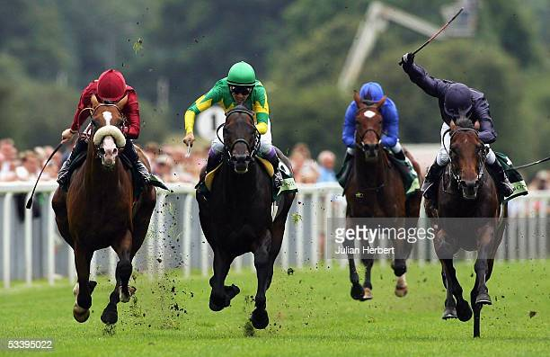 Mick Kinane and Electrocutionist lead the Yutaka Take ridden Zenno Rob Roy Doyen ridden by Kerrin McEvoy and Ace ridden by Kieren Fallon to land The...